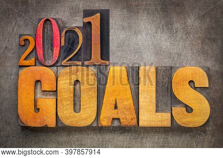 2021 goals - New Year resolutions concept - word abstract in vintage letterpress wood type blocks against grunge metal background