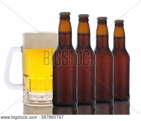 Various Kinds Of Draft Beer In Bottles, Glasses And Mugs On A White Background. Fresh Beer Brewed Wi