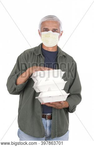Food delivery man wearing covid-19 protective mask carrying three take-out food containers. Isolated on white.