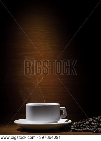 A Cup Of Coffee On A Cup. Black Americano Coffee. Coffee Cup On Brown Background. Great Coffee.