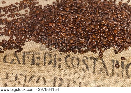 Coffee bean texture or coffee bean background. Chocolate roasted coffee beans. Close-up shot of coff