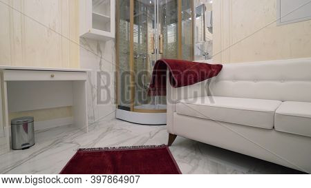 Bathroom With Shower And Sofa. Action. Beautiful Interior Of Expensive Bathroom With Shower And Sofa