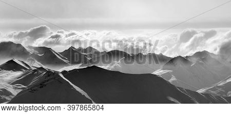 Panoramic View On Silhouette Of Evening Sunlight Snowy Mountains In Mist. Caucasus Mountains, Georgi