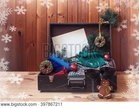 Old Suitcase With Christmas Presents, Gingerbreads Cookie In Shape Of Christmas Wreath And Woolen Sw