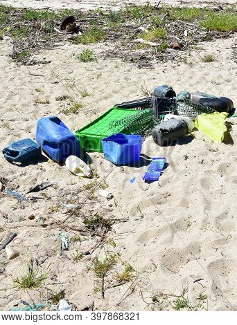 Beach With Plastic Pollution On Sand At Famous Rias Baixas Region. Coruña Province, Galicia, Spain.