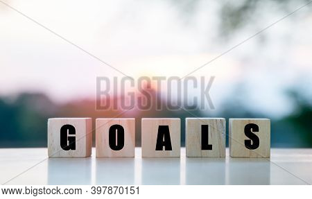 The Word Goals On A Wooden Cube, The Concept Of Setting Goals For Success.