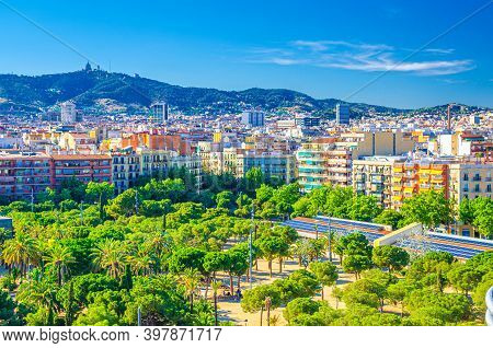 Aerial View Of Barcelona City Historical Quarters Districts With Palm Trees Park, Residential Buildi