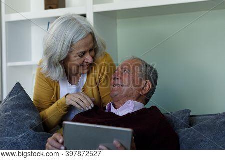 Senior caucasian couple using digital tablet at home. social distancing quarantine lockdown during coronavirus pandemic