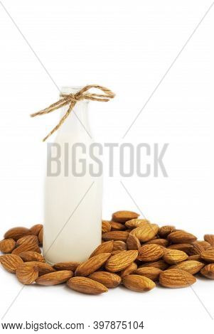 Vegetarian Almond Milk. Almonds And Almond Milk In A Bottle. Isolated On White.