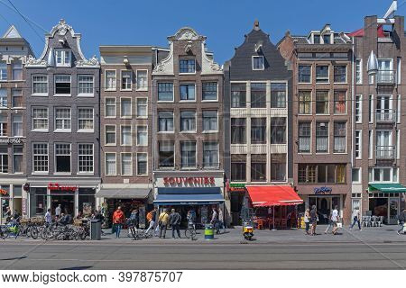 Amsterdam, Netherlands - May 14, 2018: Traditional Hosues With Shops At Street In Amsterdam, Holland