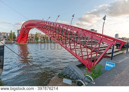Amsterdam, Netherlands - May 17, 2018: Red Bridge Pythonbrug Over Canal In East Amsterdam, Holland.