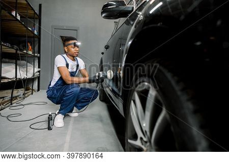 Auto Detailing Service, Polishing Of The Car. Side View Of Young African American Man Worker In Unif