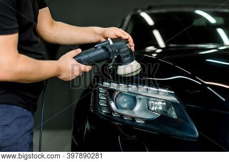 Car Polishing Process. Cropped Image Of Hands Of Male Ervice Employee In Working Clothes, Polishing