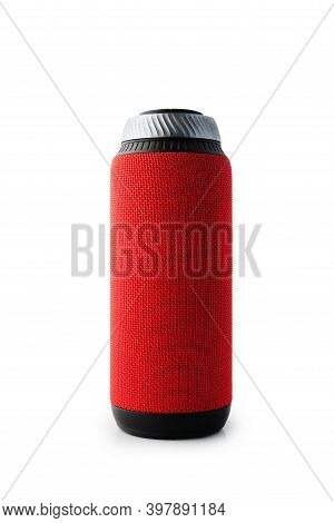 Portable Bluetooth Speaker Standing Isolated On White Background. Red Colored Cylindrical Shape.