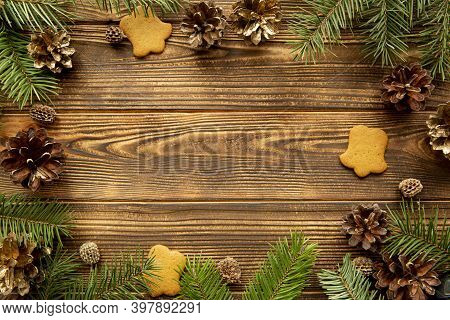 Christmas Background With Empty Copy Space For Text, Golden Pine Cones Decoration, Top View.