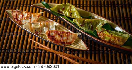 Banner Variety Asian Dumplings Gyozas With Meat And Vegetables Potstickers Fried On Ceramic Plate, S