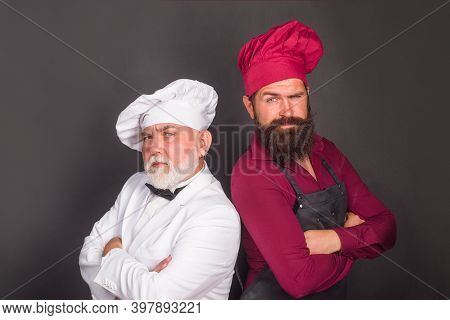 Kitchen. Two Chefs. Beared Chef Man. Delicious Food. Male Chef In Uniform. Satisfied Bearded Chef, C