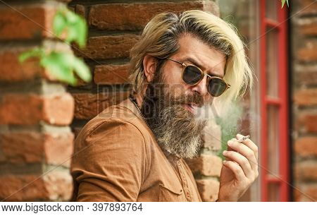 Smoking Outdoors. Smoking Habit. Fashionable Mature Man With Cigarette. Brutal Guy Sunglasses Smokin