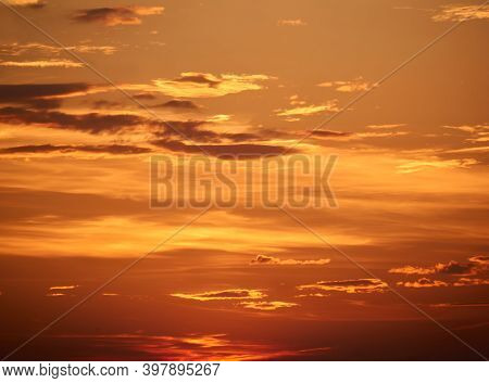 Natural Background - Bright Orange Sunset Sky With Clouds