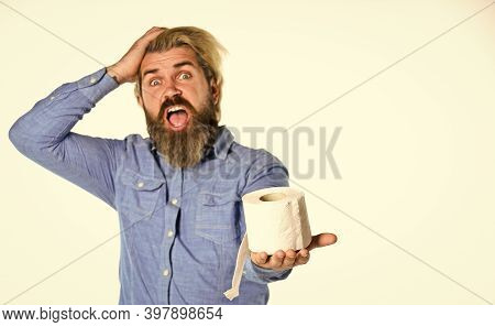 Restroom Products. Man In Public Toilet. Diarrhea Concept. Man Holding Paper Roll In Supermarket. Ro