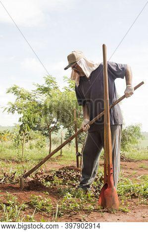 Ibitinga / Sao Paulo / Brazil - 01 23 2020: Caucasing Man Working Hard Doing Weeding On His Own Camp
