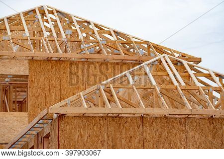 Installation Of Rafters Of A Plywood House Building Wall Studs