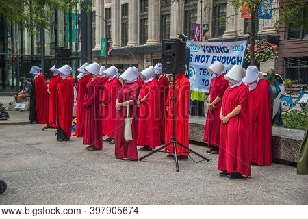 September 27, 2020, Chicago, Il A Group Of Protestors Wearing Red Handmaid's Tale Costumes At A Vote