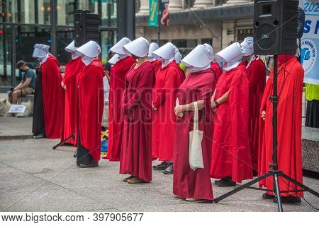 September 27, 2020, Chicago, Il A Group Of Protestors Wearing Red Handmaid\'s Tale Costumes At A Vot