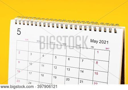 Close Up May 2021 Calendar Desk For Organizer To Plan And Reminder On Yellow Table.