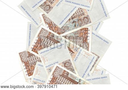 200 Croatian Kuna Bills Flying Down Isolated On White. Many Banknotes Falling With White Copyspace O