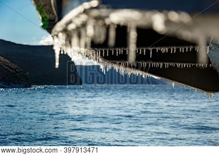 Bottom Of Ferry Ship With Icicles In Winter On Baikal Lake Near Olkhon Island
