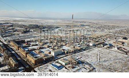 A Small Town On The Shore Of Lake Balkhash. Top View Of Houses, Cultural Buildings, Snowy Streets, G
