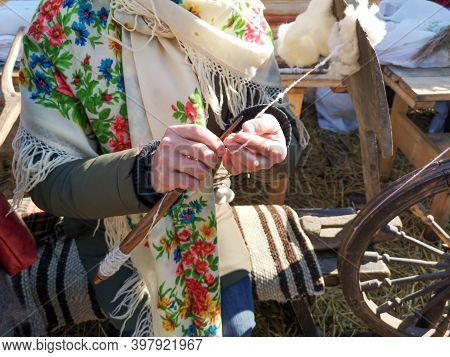 Wool Yarn By Hand On A Loom. The Old Method