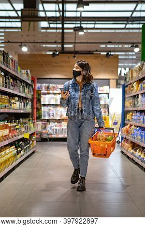 Woman Do Grocery Shopping Checking List On The Phone
