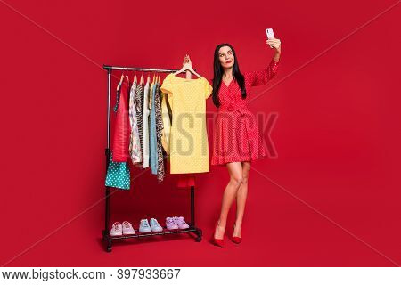 Full Length Body Size View Of Fashionista Lady Seller Making Selfie Demonstrating Wardrobe Selling I