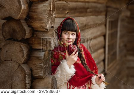 Portrait Of Little Girl In Colorful Russian Shawl On Her Head. Selective Focus And Noise. Shallow De