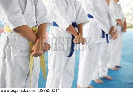 Children In Kimono During Karate Practice On Tatami, Closeup