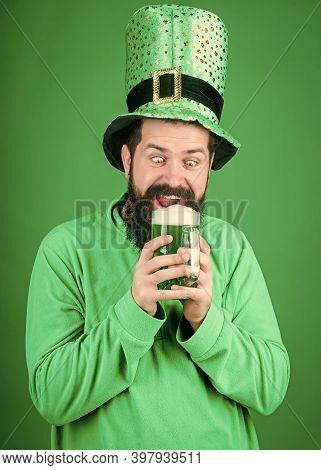 Alcohol Beverage. Lets Start Patricks Party. Irish Tradition. Man Brutal Bearded Hipster Drink Beer.