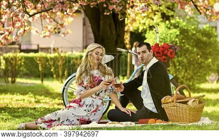 Spring Weekend. First Date Ideas Guaranteed To Win Her Heart. Couple In Love Picnic Date. Enjoying T