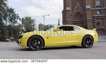 New York, Usa, 08.29.2020: Yellow Supercar Chevrolet Camaro In The City Street. Action. Side View Of