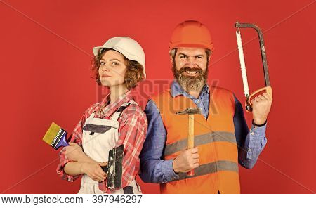 Home Renovation. Couple Renovating House. Woman Builder Hard Hat. Man Engineer Or Architect. Constru
