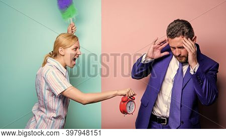 Family Conflict. Housewife And Businessman. Career And Housekeeping. Wife Stand With Dust Brush And