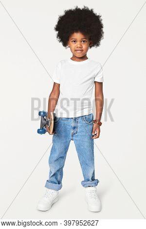 Black boy wearing t-shirt with pants in studio