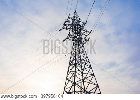 High Voltage Mast, Steel Lattice Mast For Power Transmission, With Color Sky.