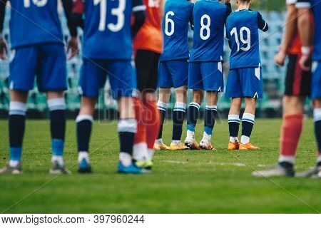 Football Players Standing In A Wall During Free Kick. Soccer League Match Of Youth Teams