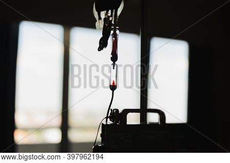 Silhouettet Blood Transfusion In Medicine Patient In Hospital.