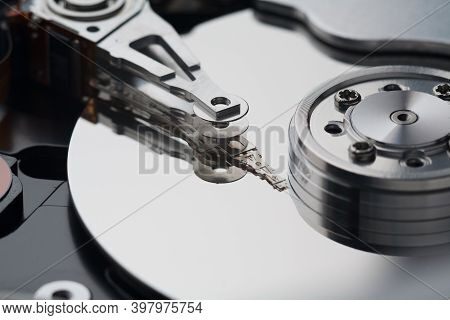 Hard Drive Disk Hdd Macro Close-up Head Of Reading And Recording Information.