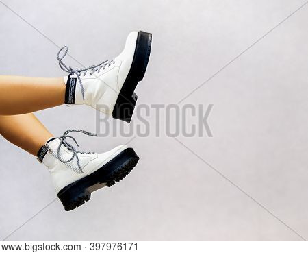 Banner For A Shoe Store Girls Legs In White Leather Shoes From The New Collection On A Light Backgro