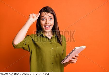 Photo Portrait Of Surprised Brunette Girl Writing Keeping Notebook Taking Off Eyewear Isolated On Vi