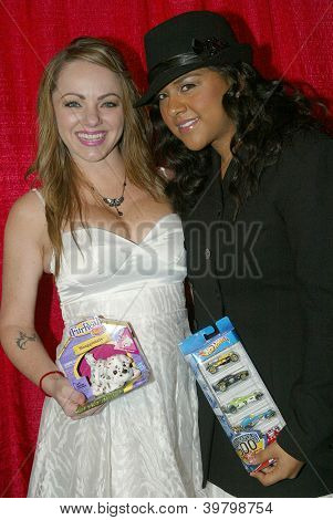 UNIVERSAL CITY - DEC. 4: Shanda Renee and guest arrive at publicist Mike Arnoldi's birthday celebration & Britticares Toy Drive for Children's Hospital on Dec. 4, 2012 in Universal City, CA.